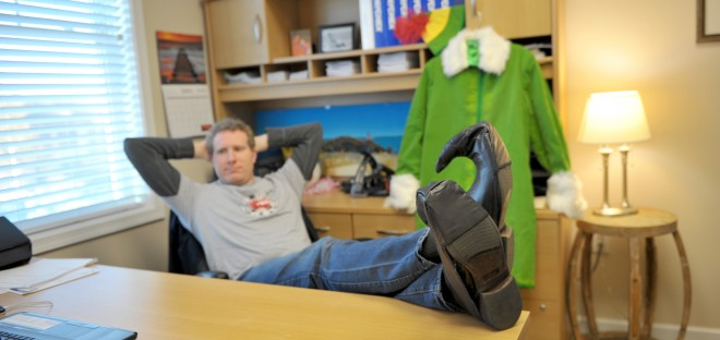 Rob at his desk with Elf shoes on